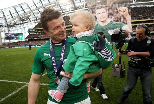 Brian O'Driscoll carries his daughter Sadie on the pitch after his final home international at the RBS Six Nations match at the Aviva Stadium, Dublin. Photo: Brian Lawless/PA Wire.