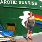 Grace O'Sullivan pictured with a Greenpeace ship, the Arctic Sunrise