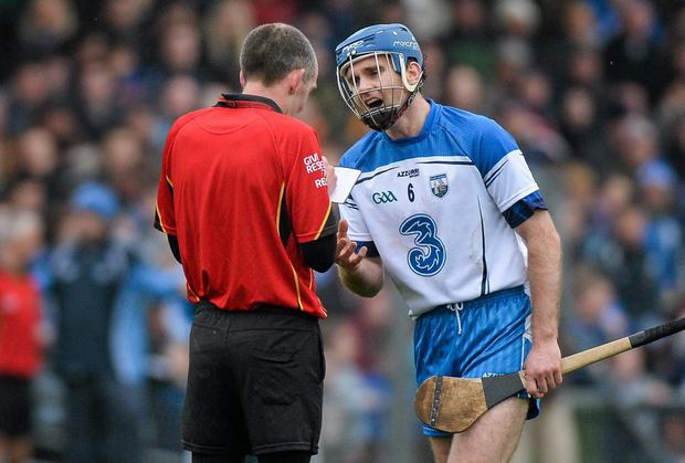 Waterford captain Michael Walsh with referee Cathal MacAlastair before he was sent off