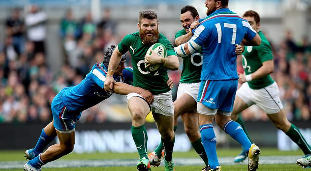 Gordon D'Arcy of Ireland is tackled by Michele Campagnaro of Italy during the RBS Six Nations match between Ireland and Italy
