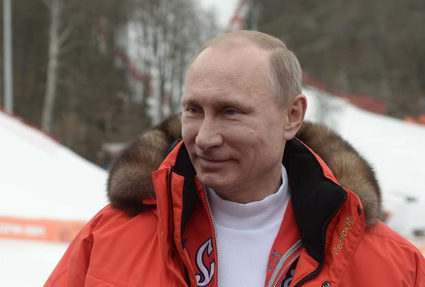 Russian President Vladimir Putin watches a men's Alpine skiing event at the Rosa Khutor center at the Sochi 2014 Winter Paralympics