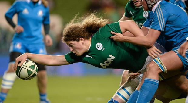 Jenny Murphy, Ireland, goes over to score a try