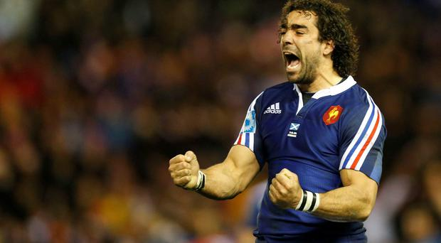 France's Yoann Huget celebrates at the final whistle following their Six Nations rugby union match against Scotland