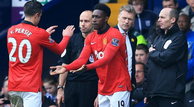 David Moyes manager of Manchester United looks on Robin van Persie of Manchester United is substituted for Danny Welbeck