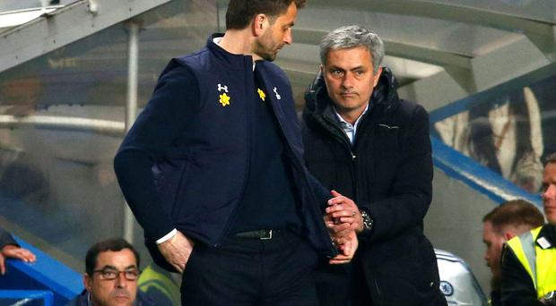 Chelsea manager Jose Mourinho shakes hands with Tottenham Hotspur manager Tim Sherwood after their English Premier League soccer match