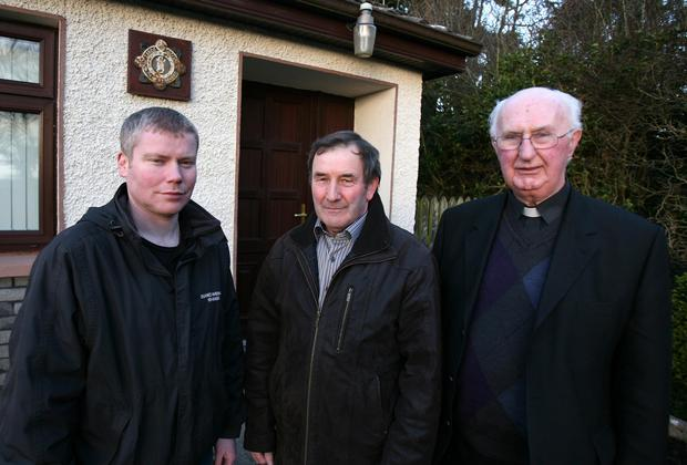 Sean Duane, Christy Corcoran and Fr Martin McNamara outside Kiltullagh Garda station, Athenry, Co Galway.