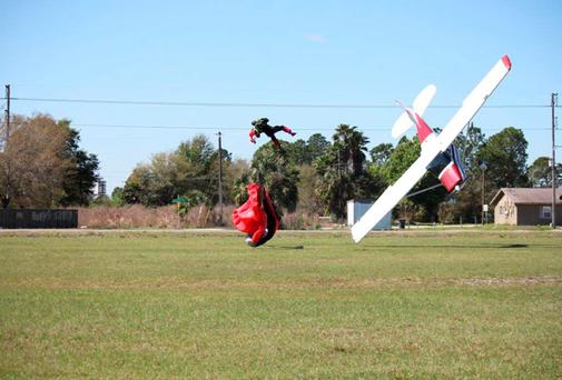 A small private plane piloted by Sharon Trembley crashes to the ground after getting tangled in the parachute of skydiver John Frost