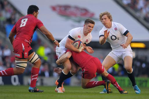 England's Owen Farrell is tackled during the RBS Six Nations match at Twickenham
