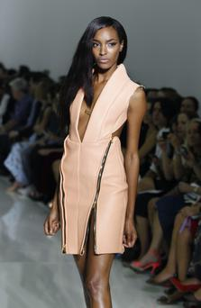 Model Jourdan Dunn presents a creation by Kanye West during the Spring/Summer 2012 ready-to-wear collection show, on October 1, 2011 in Paris