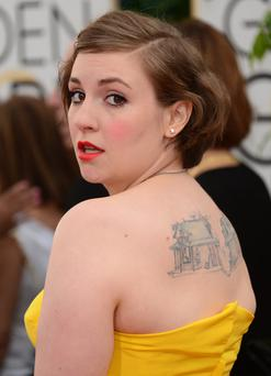 Actress and director Lena Dunham arrives on the red carpet for the Golden Globes