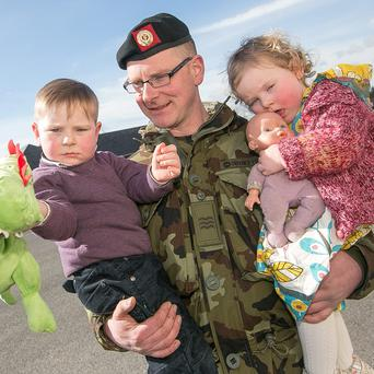 Sgt Jason Crowley from Cork is one of the troops travelling to Syria pictured with son Jack (3) who had brought his favourite dinosaur as well as daughter Aisling (18 months).
