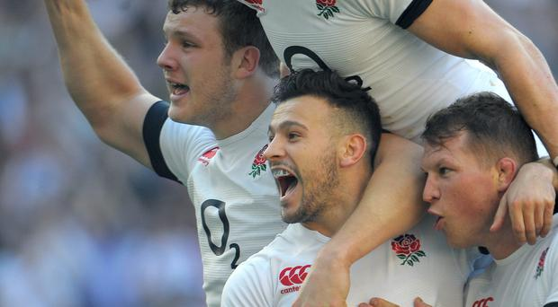 England's Danny Care (centre) celebrates scoring a try against Wales during the RBS Six Nations match at Twickenham, London