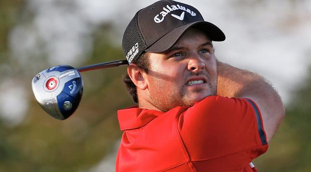 Patrick Reed watches his tee shot on the 16th hole during the final round on his way to winning the WGC Cadillac Championship in Florida
