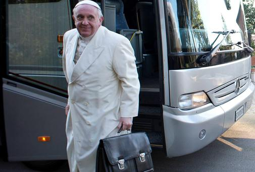 Pope Francis alights from a bus with other cardinals and bishops for a retreat in Ariccia, near Rome