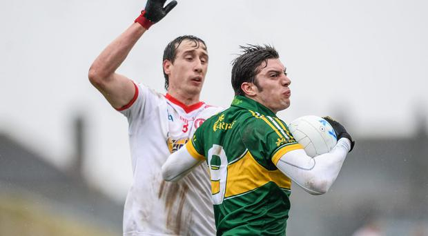David Moran, Kerry, in action against Sean Cavanagh, Tyrone