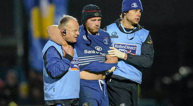 Leinster's Sean O'Brien is helped from the pitch after picking up an injury that has cut short his season