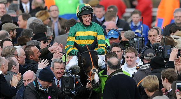 Barry Geraghty celebrates on Jezki after winning the Champion Hurdle