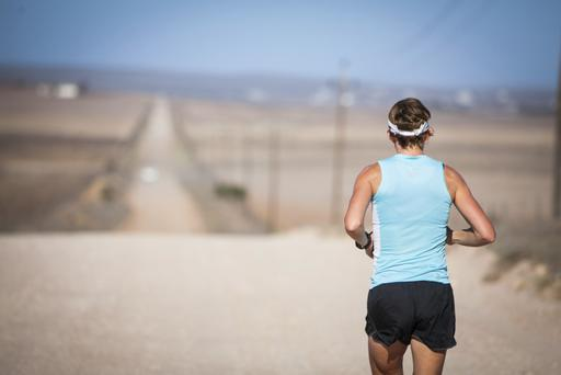 The mental effort of a tough, long run is also lessened by running within a race. Photo: Getty Images.