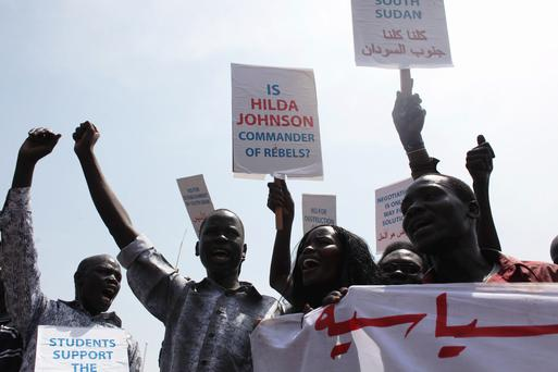 South Sudanese hold banners during a rally in support of President Salva Kiir's administration in Juba. Photo: REUTERS/Andreea Campeanu