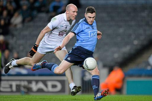 Paddy Andrews, Dublin, in action against Hugh McGrillen, Kildare