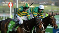 Jezki, with Barry Geraghty up, left, beat My Tent or Yours, with Tony McCoy up, to win the Champion Hurdle at Cheltenham
