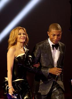 Photo of Kylie Minogue and Pharrell Williams as Minogue has revealed how Williams helped her through some tough times. Photo: Yui Mok/PA Wire