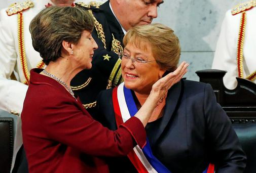 Chile's President Michelle Bachelet receives the presidential sash from Senate President Isabel Allende after she was sworn in to office in Valparaiso