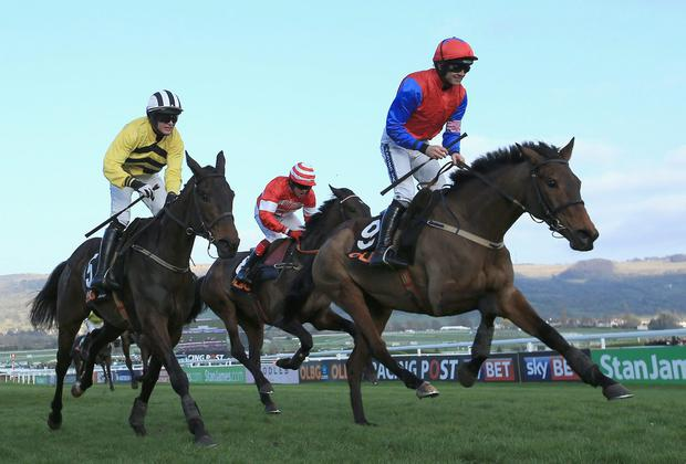 Ruby Walsh on Quevega, right, crosses the line to win The Olbg Mares' Hurdle at Cheltenham