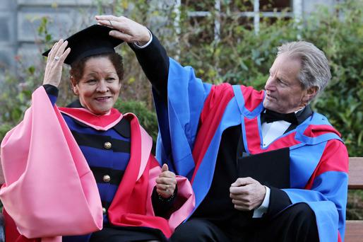 Christine Buckley, with Sam Shepard, after receiving her Doctorate of Law from Trinity College in 2012. Photo: Collins