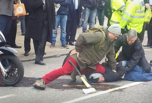 The suspect being held on the ground by a have-a-go hero