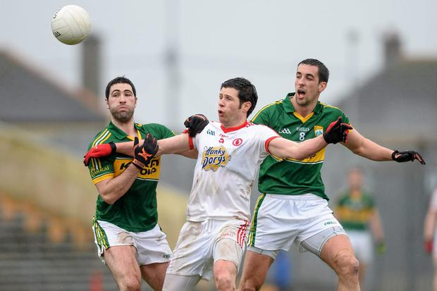 Sean Cavanagh, Tyrone, in action against Bryan Sheehan, left, and Anthony Maher, Kerry