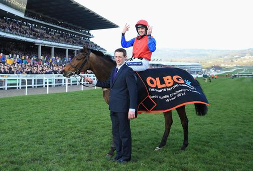 Ruby Walsh celebrates Quevega's sixth consecutive win in the Mares' Hurdle at Cheltenham