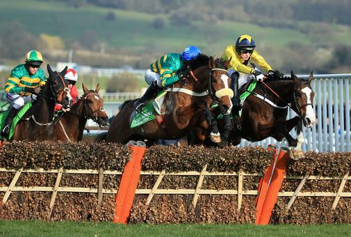 Daniel Mullins on Our Conor, right, leads the pack early on in the Champion Hurdle