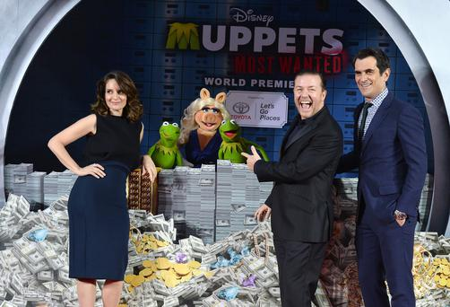 "(L-R) Tina Fey, Constantine, Miss Piggy, Kermit, Ricky Gervais and Ty Burrell arrive for the premiere of Disney's ""Muppets Most Wanted"" at the El Capitan Theatre on March 11, 2014 in Hollywood, California. (Photo by Kevin Winter/Getty Images)"