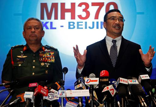 Malaysia's acting Transport Minister Hishammuddin Hussein answers questions next to Chief of Armed Forces General Zulkifeli Mohd. Zin (L) on the missing Malaysia Airlines MH370 plane. Photo: Reuters/Edgar Su