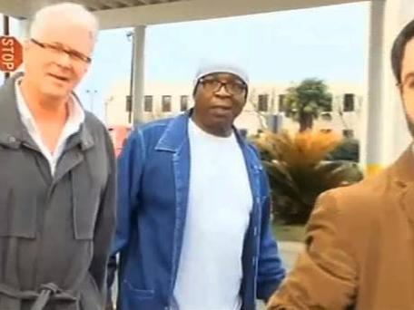 Glenn Ford, 64, center, walks out of a maximum security prison
