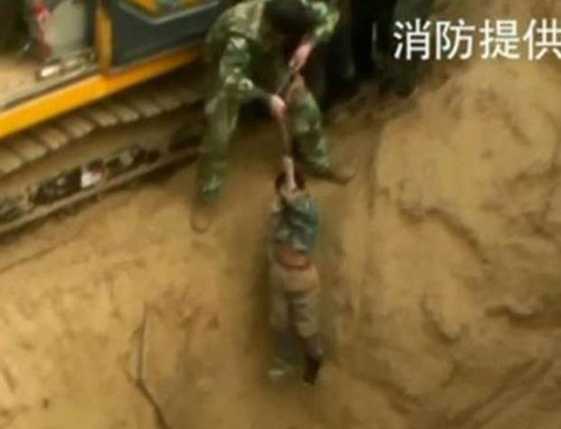 Rescue workers had to pump oxygen into the narrow chamber just to keep the boy alive while they conducted their six-hour rescue operation