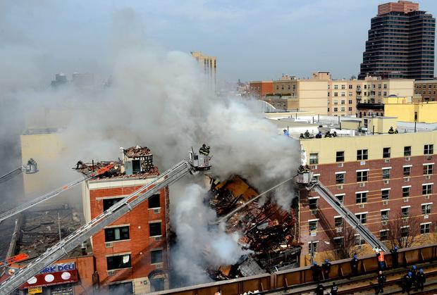 Fire Department of New York respond to a five-alarm fire and building collapse at 1646 Park Ave in the Harlem neighborhood of Manhattan