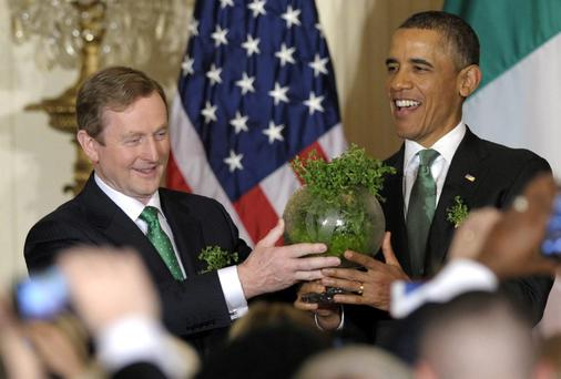US President Barack Obama and Taoiseach Enda Kenny hold up a bowl of Irish shamrocks during a St. Patrick's Day reception in the East Room of the White House in Washington, last year. AP Photo/Susan Walsh