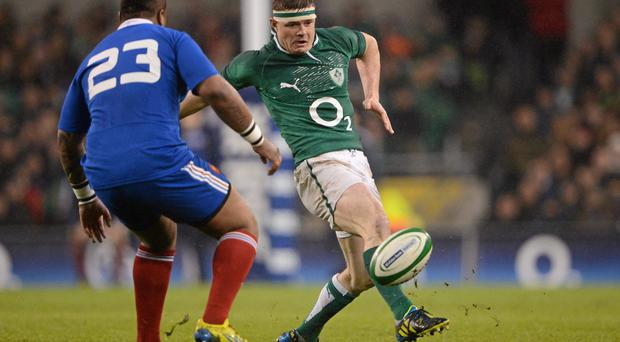 Brian O'Driscoll kicks beyond France's Mathieu Bastareaud last year