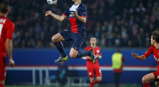 Paris St Germain's Zlatan Ibrahimovic controls the ball during their Champions League second leg tie with Bayer Leverkusen