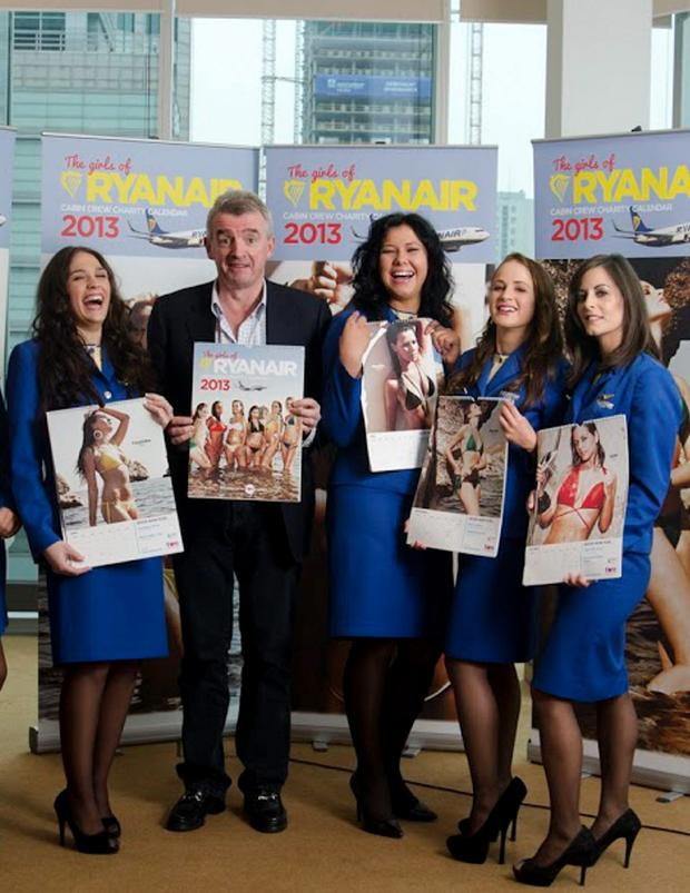 Michael O'Leary pictured with airline staff at the launch of the airline's 2013 charity calendar