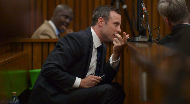 Oscar Pistorius sits in the dock as he listens to cross questioning about the events surrounding the shooting death of his girlfriend Reeva Steenkamp