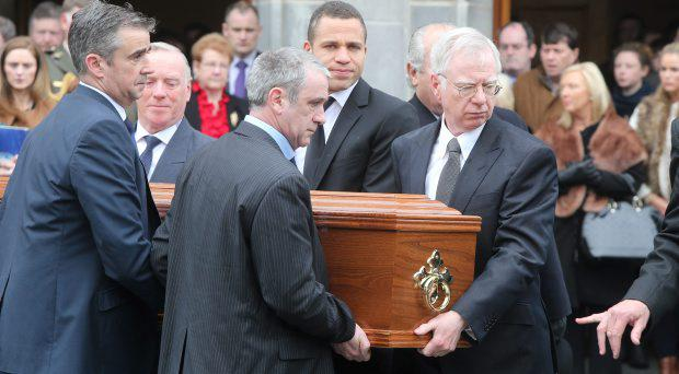 Donal Buckley, right, and his son Conor, second right, carrying the coffin at St Therese, Mount Merrion, after the funeral mass of Christine Buckley