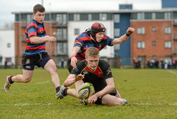 Paul McNamara of Ardscoil Ris goes over to score against St Munchin's in the semi-final