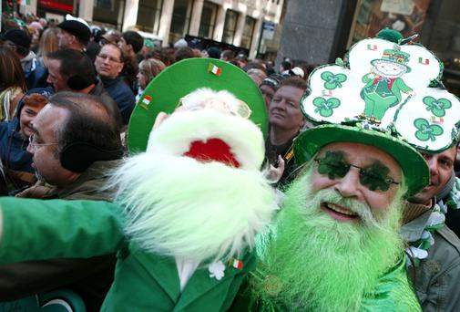 Spectators enjoying the St Patrick's Day street parade in New York. Reuters