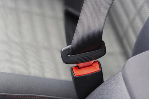 The seatbelt locking system in a car.