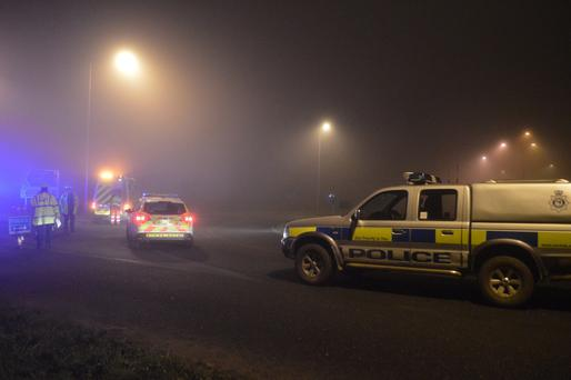 Police man a road block in Gillingham, near Beccles, Norfolk, as emergency services are attending a helicopter crash