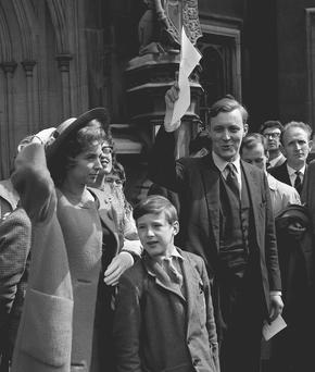 File photo dated 08/05/61 of Tony Benn holding up his certificate of election, with his wife Caroline and son Stephen, nine. The veteran politician died at home today at the age of 88, his family said in a statement.