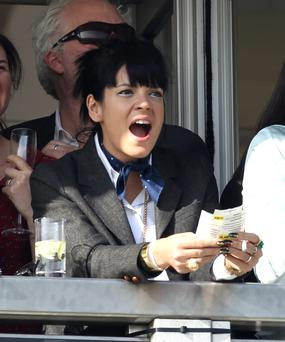 Lily Allen watches the first race on day 4 of The Cheltenham Festival at Cheltenham Racecourse on March 14, 2014 in Cheltenham, England. (Photo by Danny E. Martindale/Getty Images)